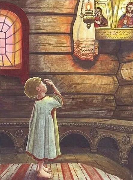 Ребенок перед иконами