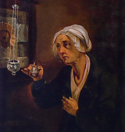 Женщина перед иконой