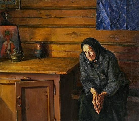 Бабушка сидит за столом