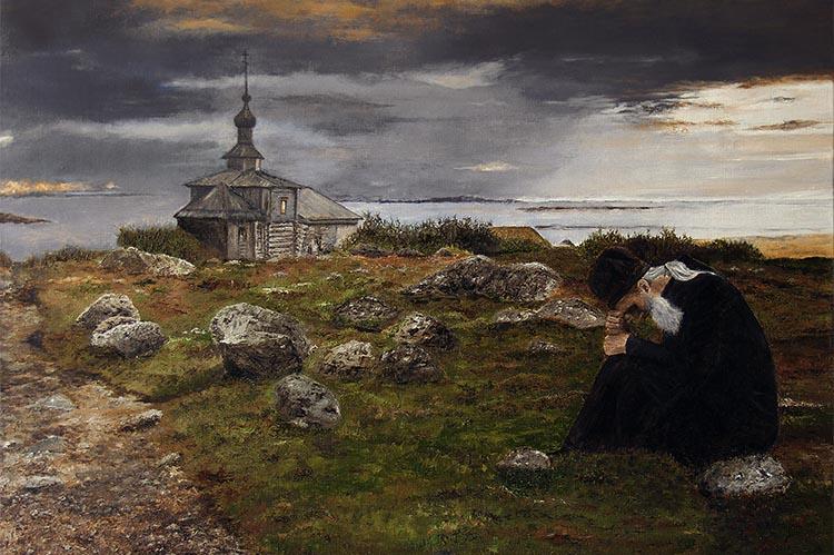 Монах сидит на камне