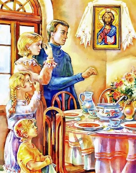 Семья молится за столом